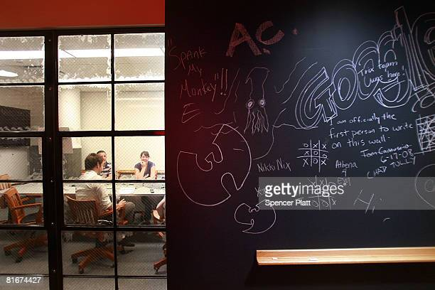 Employees of Google participate in a meeting at the internet company's new office space inside historic Chelsea Market June 23 2008 in New York City...