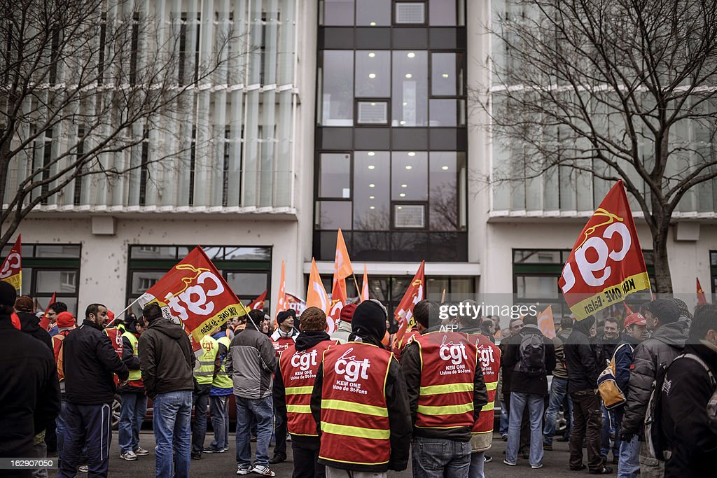 Employees of Kem One, a company specializing in chlorochemicals and vinyl products, demonstrate to keep their jobs, on March 1, 2013 in front of Kem One's headquarters in Lyon.
