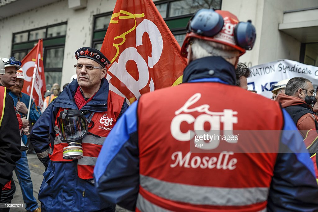 Employees of Kem One, a company specializing in chlorochemicals and vinyl products, demonstrate to keep their jobs, on March 1, 2013 in front of Kem One's headquarters in Lyon. AFP PHOTO / JEFF PACHOUD