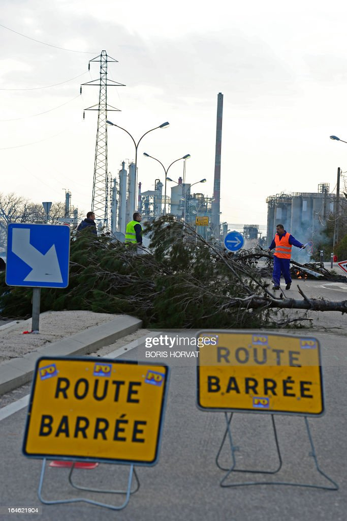 Employees of Kem One, a French company specialized in chlorochemicals and vinyl products, block the access to their company in Lavera, southern France, on March 25, 2013 after French unions announced the company's cessation of payments. 350 jobs could be cut on the Lavera site.