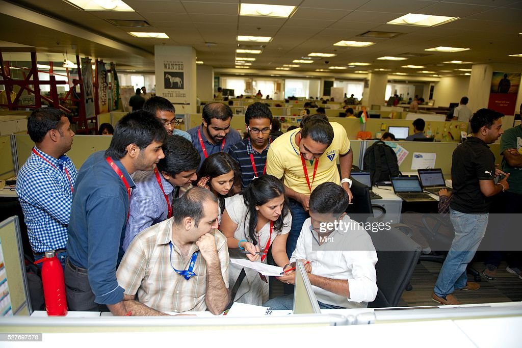 Employees of Makemy Trip office poses on their Induction Day Shoot on August 3, 2015 in New Delhi, India.