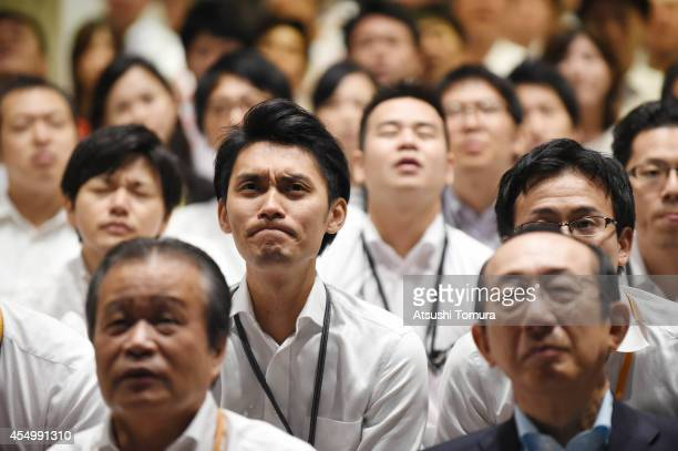 Employees of Nissin Foods Holdings Co show their disappointment after Kei Nishikori of Japan loses a point in the men's singles final match of the...