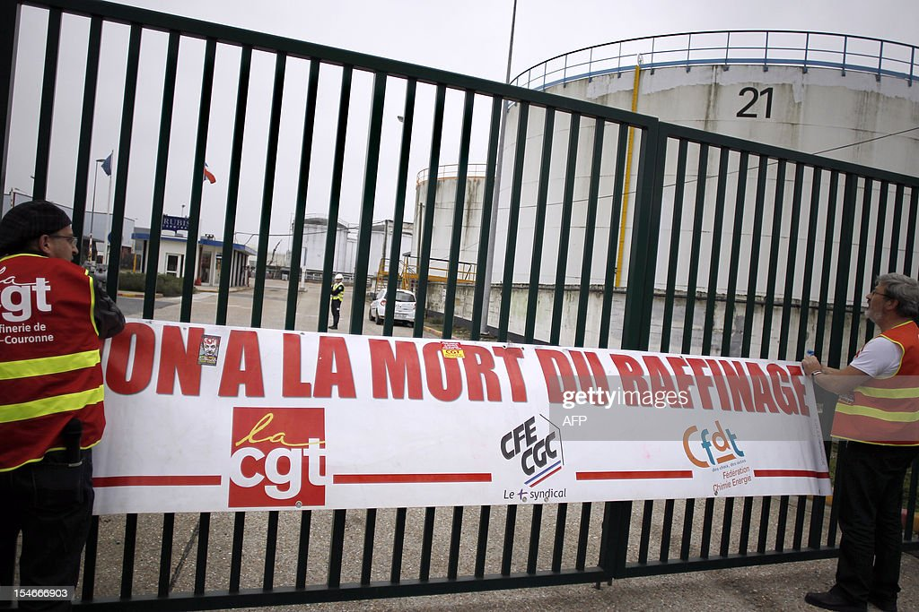 Employees of Petroplus oil refinery display a poster at the entrance of the 'Rubis' oil terminal on October 24, 2012 in Petit-Couronne, northwestern France. The court in Rouen ordered the liquidation of Petroplus on October 16, 2012, despite two offers for the site that employs 470 people. The court left open the possibility for other bidders to come forward by November 5 however, amid widespread anger among the refinery's workers. AFP PHOTO/CHARLY TRIBALLEAU