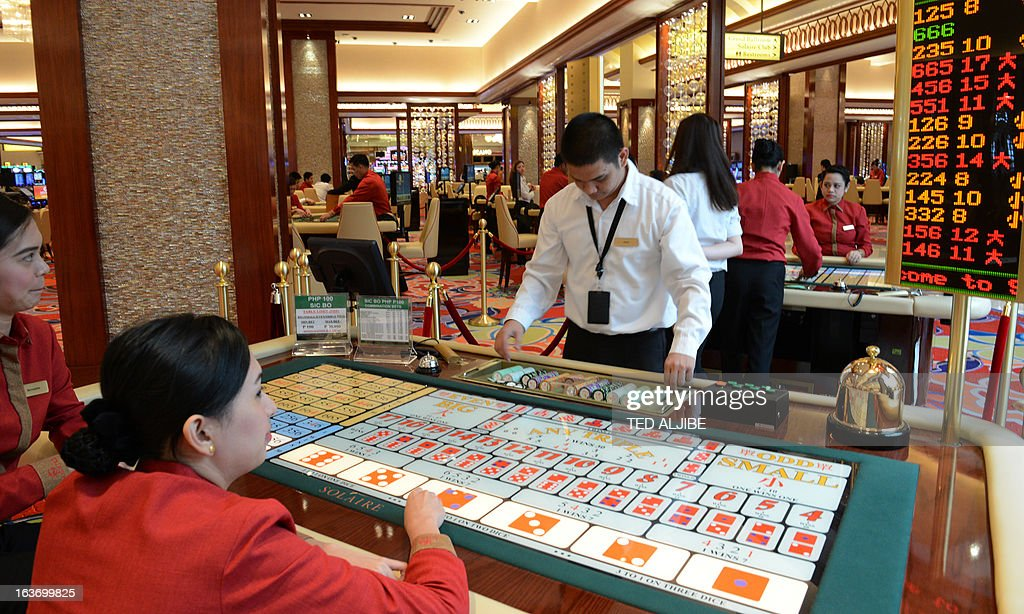 Employees of Solaire Manila Resorts and casino simulate a game during media day, inside the casino in Manila on March 14, 2013, ahead of its opening on March 16. The Philippines makes its biggest bet this weekend in a high-stakes bid to join the world's elite gaming destinations, with the launch of a $1.2-billion casino on Manila Bay.Solaire Manila Resorts is the first of four enormous entertainment venues slated to rise over a giant chunk of prime, reclaimed land that industry and government leaders expect will attract millions of cashed-up Asian tourists.