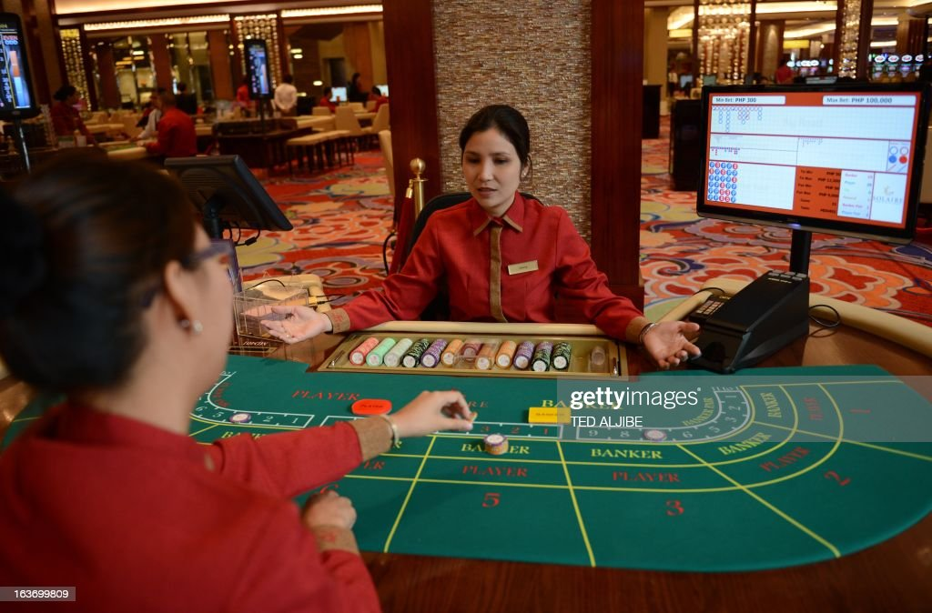 Employees of Solaire Manila Resorts and casino simulate baccarat game during media day inside the casino in Manila on March 14, 2013, ahead of its opening on March 16. The Philippines makes its biggest bet this weekend in a high-stakes bid to join the world's elite gaming destinations, with the launch of a $1.2-billion casino on Manila Bay.Solaire Manila Resorts is the first of four enormous entertainment venues slated to rise over a giant chunk of prime, reclaimed land that industry and government leaders expect will attract millions of cashed-up Asian tourists.