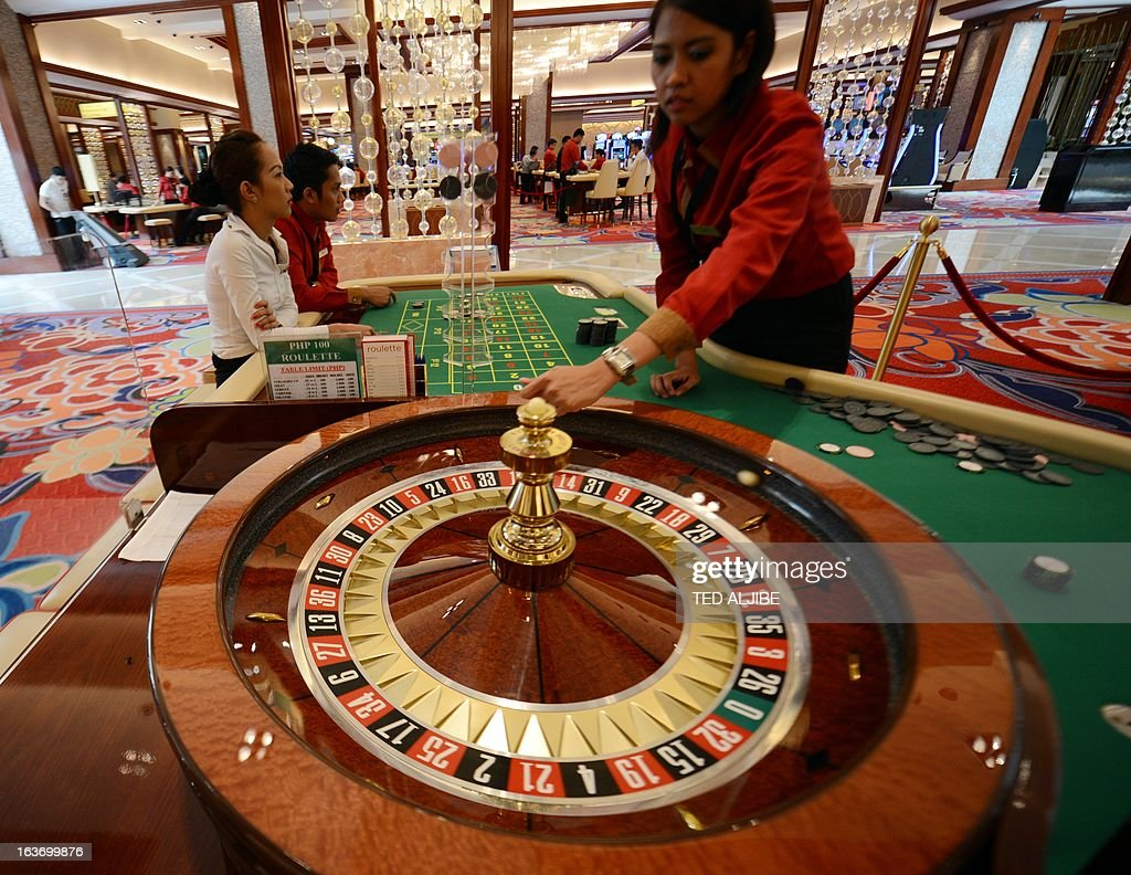 Employees of Solaire Manila Resorts and casino simulate roulett game during media day inside the casino in Manila on March 14, 2013, ahead of its opening on March 16. The Philippines makes its biggest bet this weekend in a high-stakes bid to join the world's elite gaming destinations, with the launch of a $1.2-billion casino on Manila Bay.Solaire Manila Resorts is the first of four enormous entertainment venues slated to rise over a giant chunk of prime, reclaimed land that industry and government leaders expect will attract millions of cashed-up Asian tourists. AFP PHOTO/TED ALJIBE