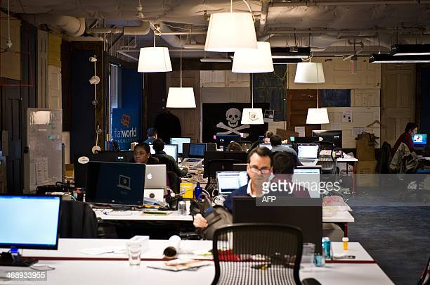 Employees of startup companies work at their designated spaces at the offices of 1776 business incubator in Washington DC February 11 2014 1776 hosts...
