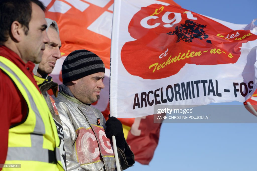 Employees of the ArcelorMittal plant of Fos-sur-Mer take part in the site blockade, on December 6, 2012 in Fos-sur-Mer, in support of employees of the group's plant in Florange, eastern France. French local newspaper Le Republicain Lorrain and other medias revealed that either Russian Severstal or Belgian CMI steel groups were reportedly the investors ready and willing to put 400 million euros ($515 million) into the Florange steel plant, at the centre of a dispute between the owner ArcelorMittal and the government. AFP PHOTO ANNE-CHRISTINE POUJOULAT