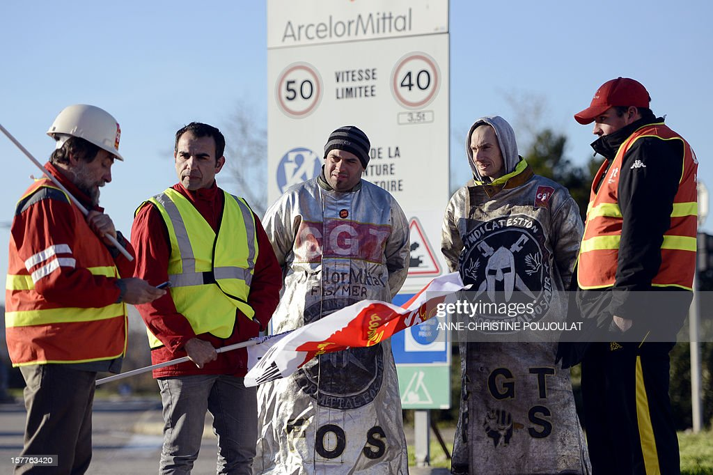 Employees of the ArcelorMittal plant of Fos-sur-Mer take part in the site blockade, on December 6, 2012 in Fos-sur-Mer, in support of employees of the group's plant in Florange, eastern France. French local newspaper Le Republicain Lorrain and other medias revealed that either Russian Severstal or Belgian CMI steel groups were reportedly the investors ready and willing to put 400 million euros ($515 million) into the Florange steel plant, at the centre of a dispute between the owner ArcelorMittal and the government.