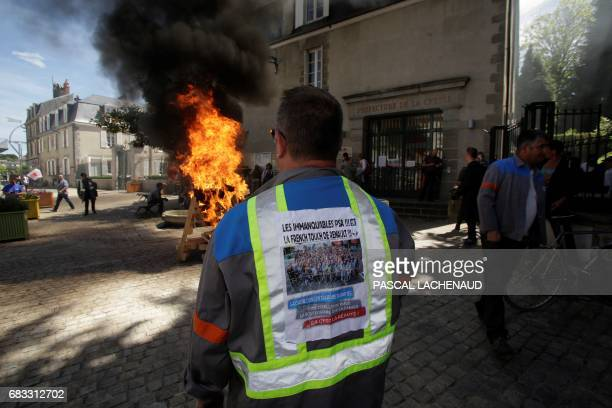 Employees of the automotive supplier Industry in La Souterraine gather during a demonstration outside the prefecture of Gueret on May 15 2017 during...