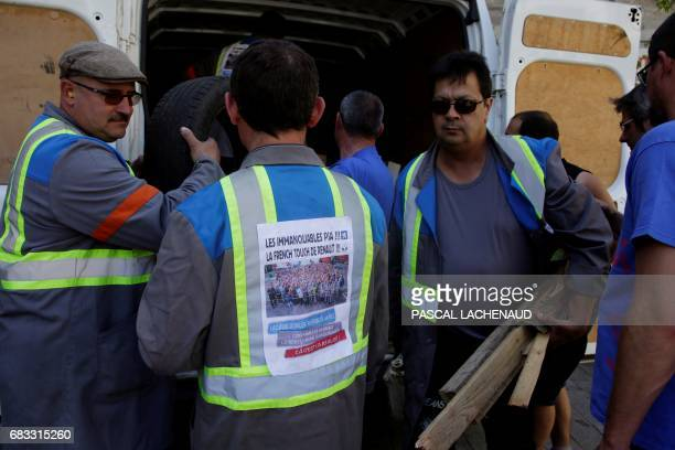 Employees of the automotive supplier Industry in La Souterraine take part in a protest outside the prefecture of Gueret on May 15 2017 during a...
