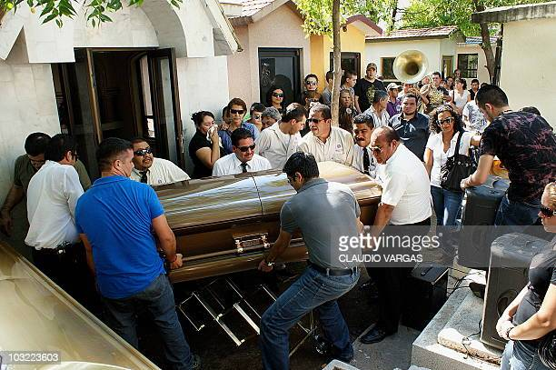 Employees of the cemetery carry the coffin with the remains of Ignacio 'Nacho' Coronel during his funeral at the Culiacan cemetery on August 03 2010...
