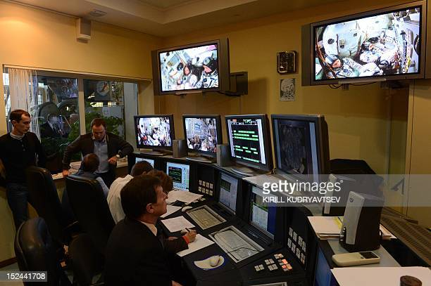 Employees of the Cosmonaut Training Centre watch the final preflight practical examination of the next expedition to the International Space Station...