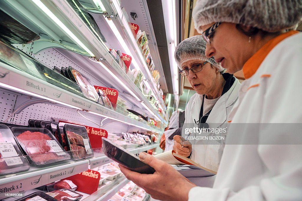 Employees of the DDCSPP (Departmental Directorate of Social Cohesion and Protection of Populations) conduct a verification of the origine of the meat in a supermarket in Besançon, eastern France, on March 1, 2013. An Europe-wide food fraud scandal over horsemeat sold as beef emerged in mid-January when Irish authorities found traces of horse in beefburgers made by firms in Ireland and Britain and sold in supermarket chains including Tesco and Aldi. The scandal intensified earlier this month when Comigel -- a French frozen meal maker which bought 500 tonnes of mislabelled horsemeat from Spanghero -- alerted Findus to the presence of horsemeat in the meals it had made for the food giant and which were on sale in Britain.