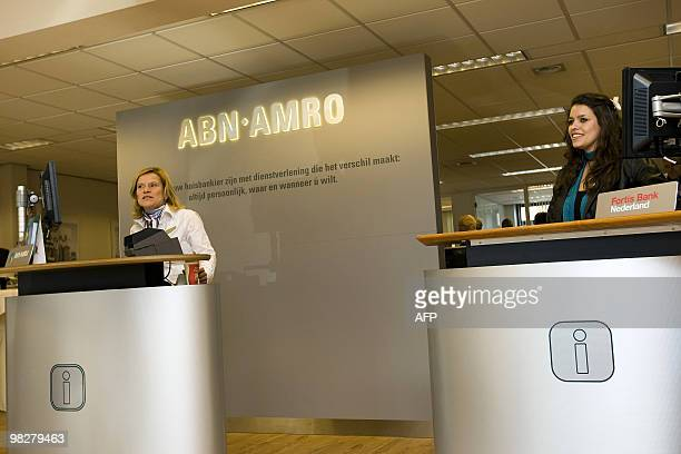 Employees of the Dutch banks ABN Amro and Fortis Bank Netherlands are present at the opening of the first combined office of the two banks in Nuenen...