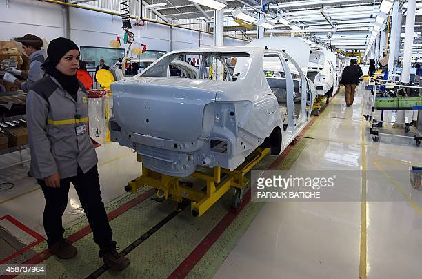 Employees of the French car maker Renault group work on a new production line during its inauguration on November 10 in Oued Tlelat in the south of...