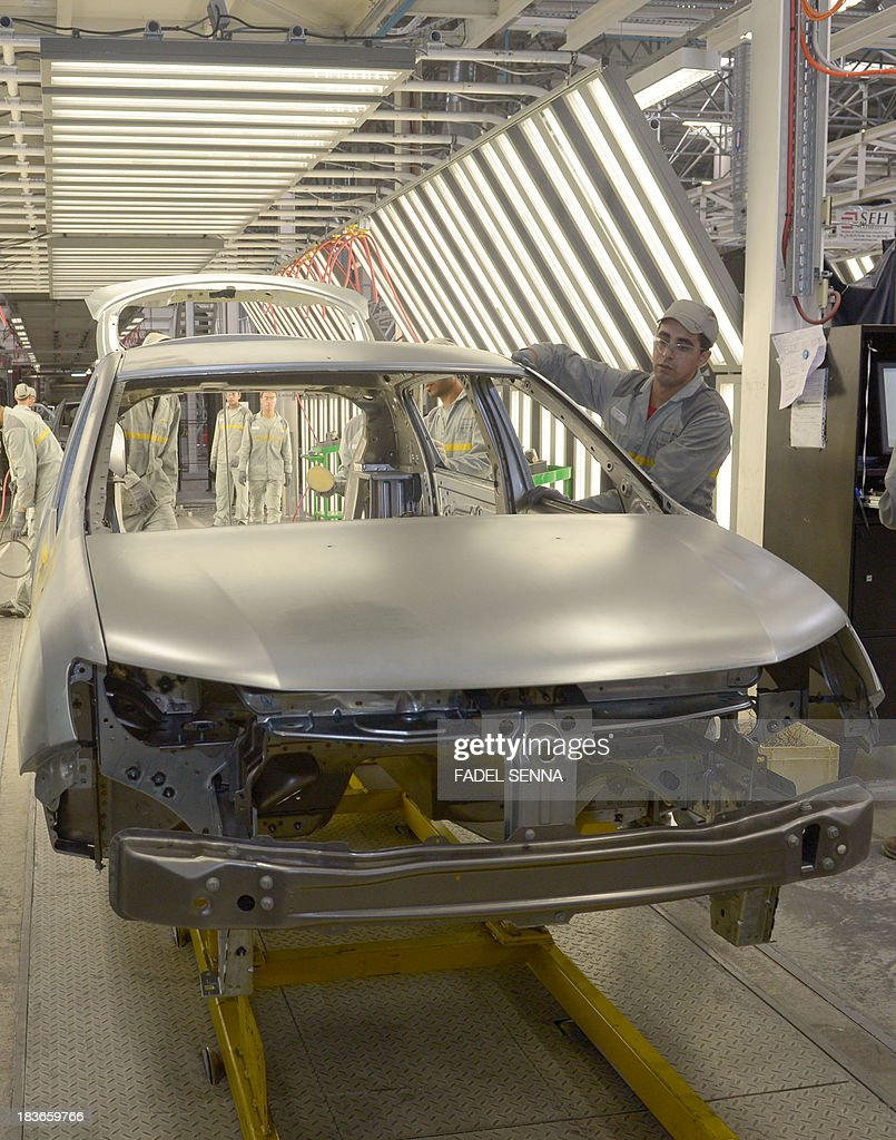 Employees of the French Renault group in Morocco work on a production line at the new second phase of the Renault factory in Tangier on October 8, 2013. This second unit inaugurated on October 8 which will oversee the production of the Dacio Sandero car, will allow the French manufacturer to double its production, to reach 340,000 vehicles per year in 2014, which will make Renault Tangier 'the biggest factory' of its type in Africa, according to its managers.