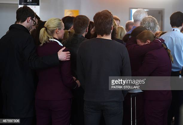 Employees of the German airline Lufthansa and Germanwings observe a minute of silence to pay tribute to the victims of a Germanwings airplane crash...