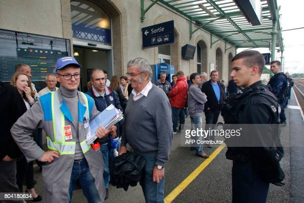 Employees of the GMS La Souterraine factory demonstrate at a train station as police officers stand guard on June 30 2017 in La Souterraine After...