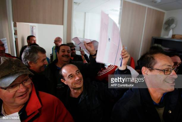 Employees of the GMS La Souterraine factory wave applications for unemployment on June 30 2017 in La Souterraine After months of strained...