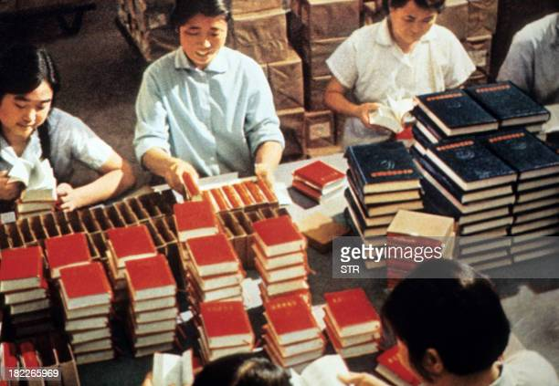 Employees of the Government Printing House pack in 1971 in Bejing copies of Mao Zedong's 'Little Red Book' the bible of the Maoism teaching the...