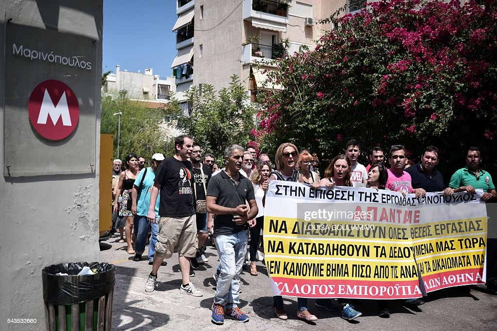 Employees of the Greek largest retail chain Marinopoulos, Carrefour's franchise partner in Greece and some Balkan countries, march towards company's building after breaking into company's premises in Southern Athens on June 29, 2016 after the company filed for protection from its creditors, under the threat of confiscations. Marinopoulos, Greeces biggest supermarket chain, is on the verge of bankruptcy. If its application is rejected some 12,500 employees will be left jobless and over 2,000 suppliers and creditors will lose money, creating an unprecedented situation in the Greek market. / AFP / LOUISA