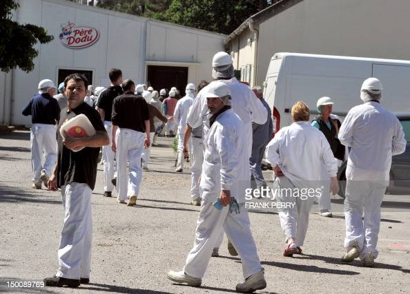 Employees of the group Doux Europe's top producer of poultry and processed chicken leave after a meeting on August 10 2012 in the western French city...