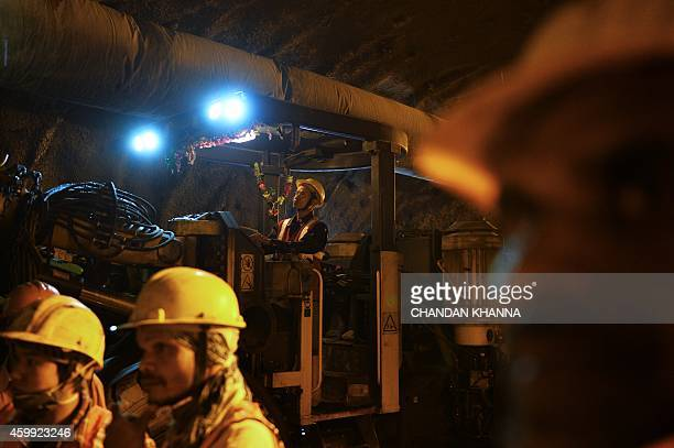 Employees of the Indian Delhi Metro Rail Corporation work in an underground construction tunnel site between Kalkaji Mandir and Okhla Phase 3 in New...