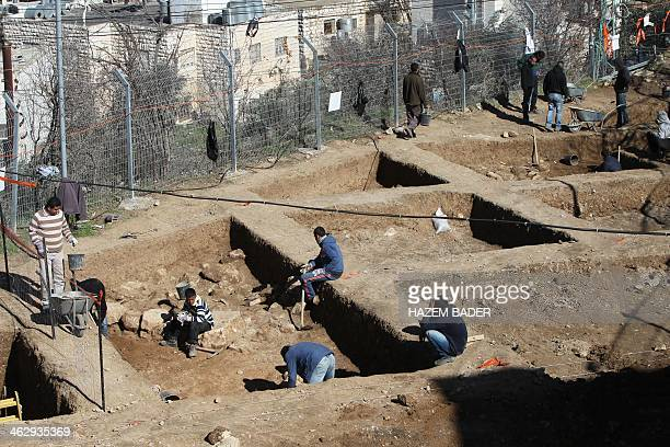 Employees of the Israeli Antiquities Authority excavate an archaeological site at Tel Rumeida in the heart of the West Bank city of Hebron's historic...