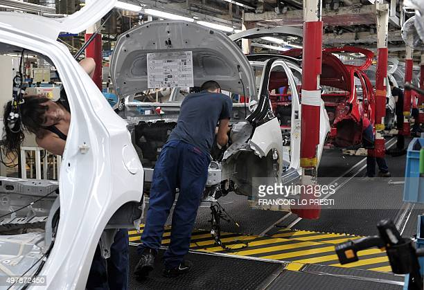 Employees of the Japanese automotive manufacturer Toyota work on the assembly line of the Yaris 3 car on November 18 2015 at the Toyota plant in the...