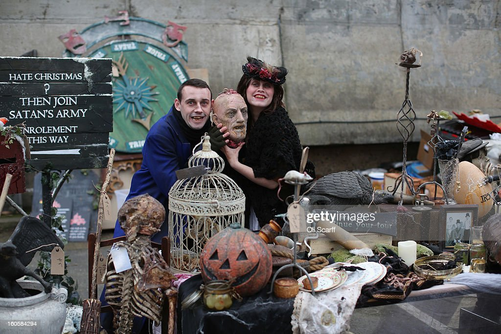 Employees of 'The London Dungeon' pose with props previously used at the attraction which are to be sold at a car boot sale in Pimlico as the Dungeon prepares to move to new premises on the Southbank, on February 3, 2013 in London, England. The sale features a selection of torture and surgical implements, costumes, plague doctor's potions, false eyeballs, severed limbs, and a set of stocks. The London Dungeon will reopen in March 2013 in larger premises on the Thames' Southbank, having moved from Tooley Street where it originally opened 38 years ago.