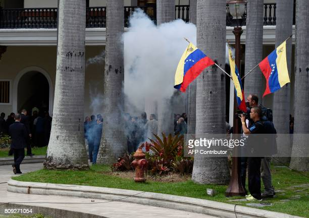 Employees of the National Assembly and members of the press run as Supporters of Venezuelan President Nicolas Maduro storm the building in Caracas on...