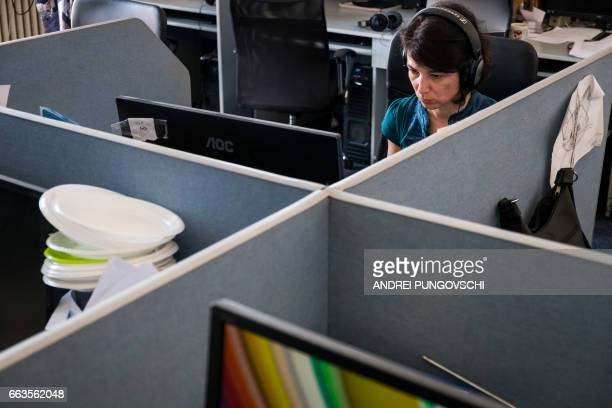 Employees of the National Audiovisual Council of Romania the state authority that monitors TV and radio stations are pictured at the main...