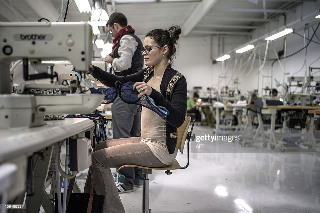 Employees of the new lingerie company 'Les Atelieres' work in Villeurbanne, centraleastern France, on January 14, 2013. 'Les Atelieres' was founded after the recent decline of the lingerie company Lejaby and employs six former workers of Lejaby, amongst its 26 employees. It launched production today.