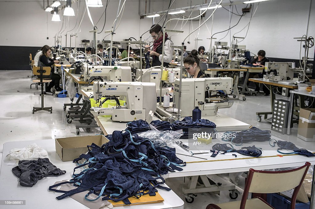Employees of the new lingerie company 'Les Atelieres' work in Villeurbanne, centraleastern France, on January 14, 2013. 'Les Atelieres' was founded after the recent decline of the lingerie company Lejaby and employs six former workers of Lejaby, amongst its 26 employees. It launched production today. AFP PHOTO / JEFF PACHOUD