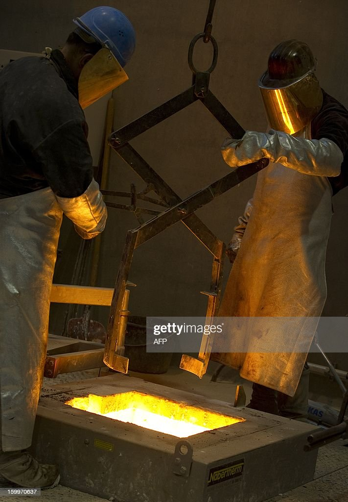 Employees of the Noack foundry pour melted silicon bronze into a mould to cast the Golden Bear trophy for the upcoming Berlinale Film Festival in Berlin, Germany on January 23, 2013. The prestigious trophy has been crafted by the Noack Fine Art Foundry, family enterprise, since 1951. The Berlinale is the first major European film festival of the year 2013, running from February 7 to 17. AFP PHOTO / BARBARA SAX