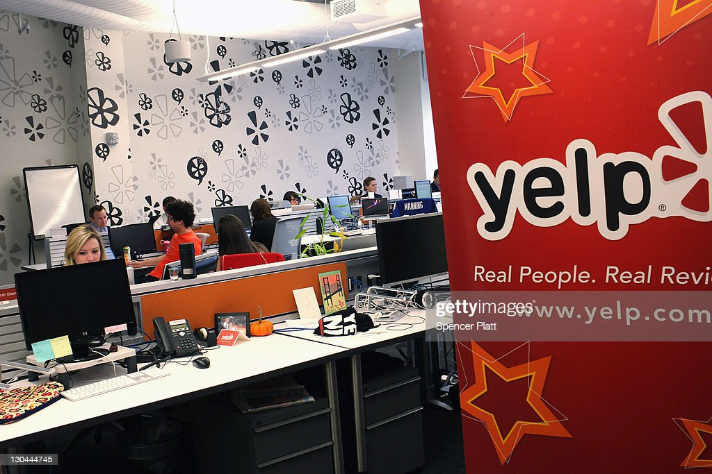 Employees of the online review site Yelp watch as New York City Mayor Michael Bloomberg speaks at the new East Coast headquarters of the tech company on October 26, 2011 in New York City. The Bloomberg administration has been heralding and working to facilitate the tech sector in New York City in hopes of making New York City a rival to Silicon Valley for start-up companies.