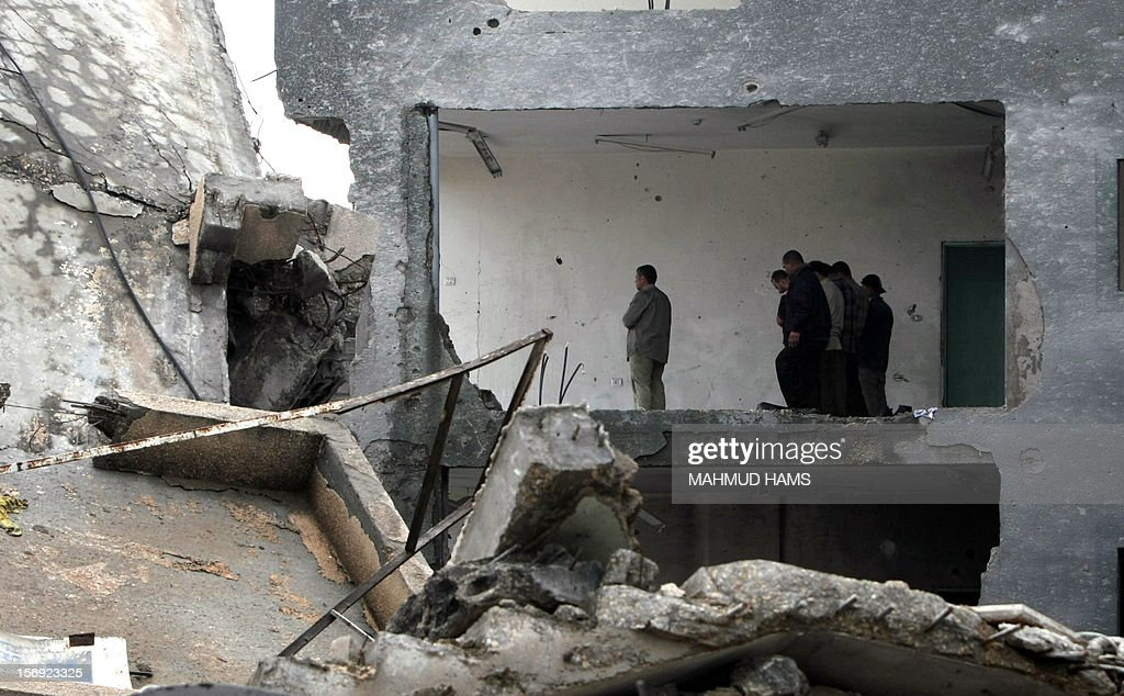 Employees of the Palestinian Interior ministry pray in the rubble of the Interior Ministry building in Gaza City on November 25, 2012, days after a truce between Hamas and Israel, ended eight days of cross border attacks in which 166 Palestinians and six Israelis died.