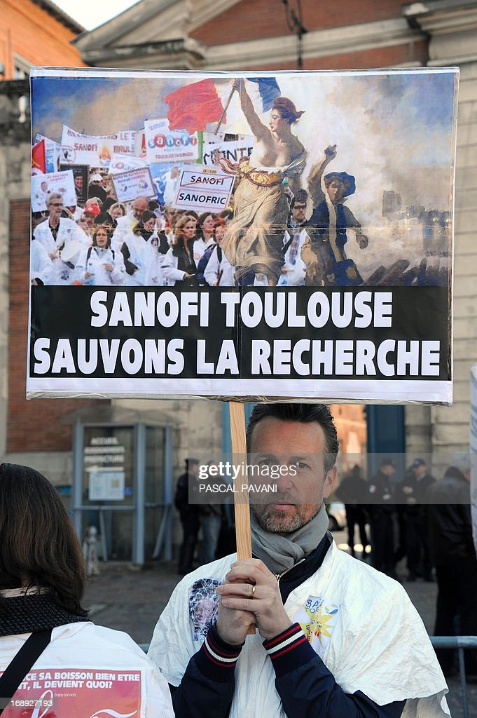 Employees of the pharmaceutical giant Sanofi demonstrate in front of the prefecture of the Region Haute-Garonne in Toulouse, southwestern France, on May 17, 2013, after the presentation of the conclusions of the report on the future site of Sanofi in Toulouse. The pharmaceutical group Sanofi 'accept' the recommendations of the ministerial report on the future site of Toulouse announced today, French Minister for Industrial Recovery, said.