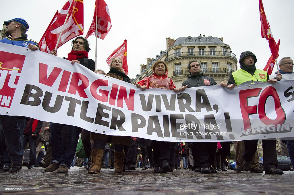 Employees of the retailer Virgin France Megastore hold a banner which reads : 'Virgin will leave, Butler has to pay !' as they demonstrate in front of the store on the Champs-Elysees avenue, on Juanuary 29, 2013 in Paris. Megastore music and book unit, which is known in France as a 'culture' retailer, said two weeks ago it will file for insolvency. Originally started by Richard Branson, the British billionaire and chairman of the Virgin Group, the Virgin megastores were bought by the French Lagardere group in 2001 before French-American businessman Walter Butler became the majority shareholder. Butler announced on January 20, 2013, its failure to relaunch the stores.