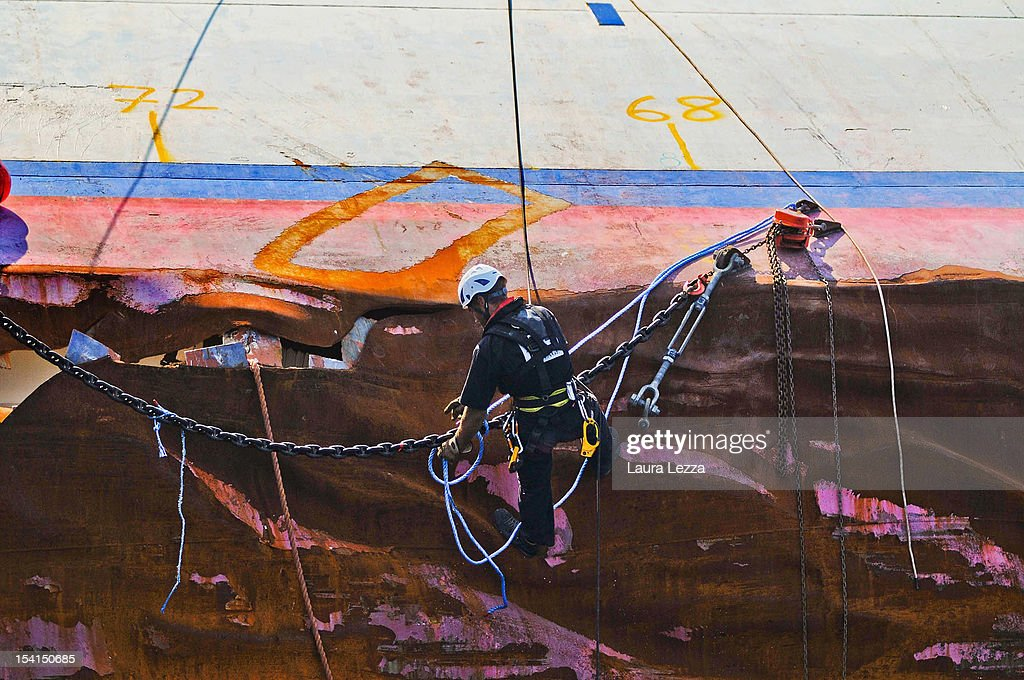 Employees of Titan-Micoperi are seen near the hull breach of Costa Concordia, which is the subject of the investigations of the Codacons experts on July 25, 2012 in Giglio Porto, Italy. The College expert Codacons is a group of university professors and experts engaged in the work of data analysis of the black box and procedural documents relating to the investigation of the sinking of the Costa Concordia cruise liner. A preliminary court hearing into the incident starts on October 15, 2012 in Grosseto, Italy, during which experts will present their findings.