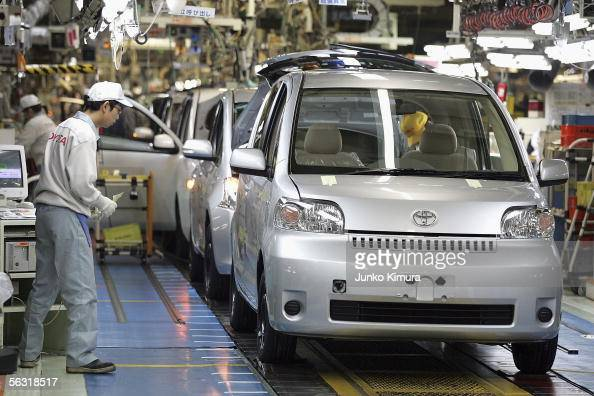 Employees of Toyota Motor Corporation work during the assembly process ...