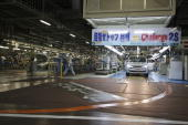 Employees of Toyota Motor Corporation work on the final line at the company's Takaoka Plant on December 2 2005 in Toyota Aichi Prefecture Japan...