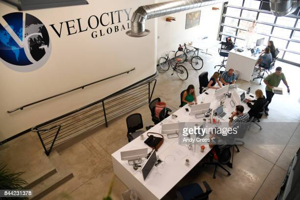 Employees of Velocity Global at work at their office inside Industry Denver coworking space September 08 2017
