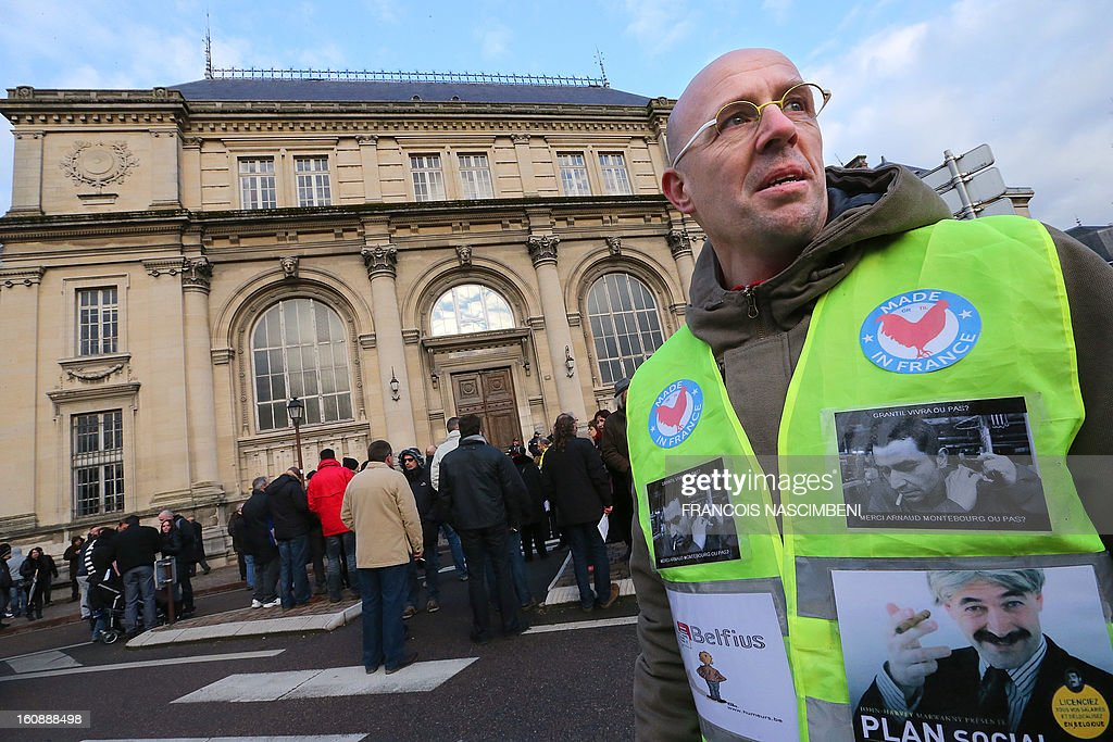Employees of wall paper maker Grandeco wait on February 7, 2013 in front of the Chalon-en-Champagne court house, as the court should confirm the bankruptcy of the company. PHOTO