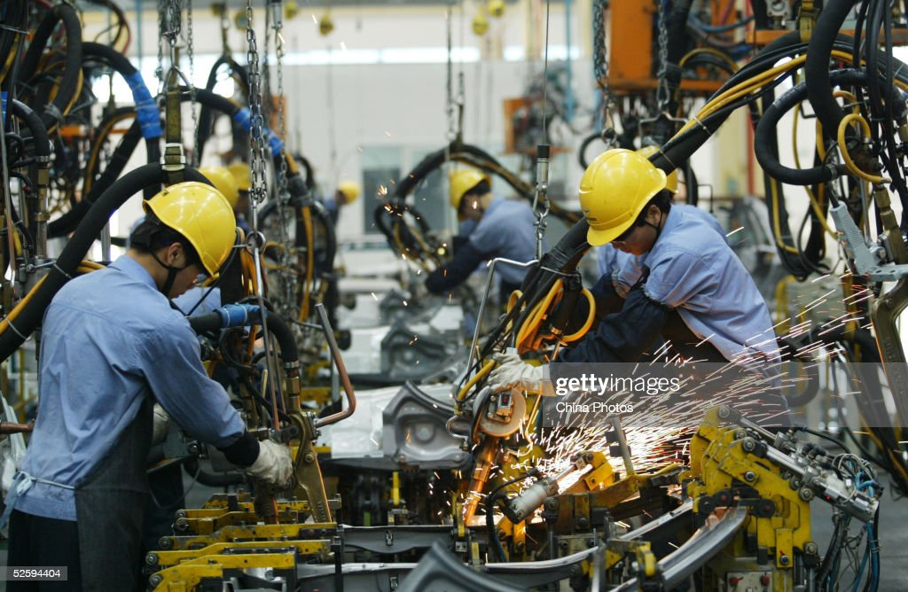 Employees on the assembly line produce cars in Mazda's 'Family' line of vehicles at China First Automobile Works (FAW) Group Haima Automobile Co., Ltd. April 6, 2005 in Haikou, Hainan Province, China. China has become the world's third largest automotive market with 2004 car sales in the country growing 15.17 percent to 2.33 million units, even though curbs on credit reduced demand. The market began slowing by mid-2004, affected by the government's measures to cool a fast-expanding economy. Analysts expect car sales in China to increase in 2005 by 10 percent.