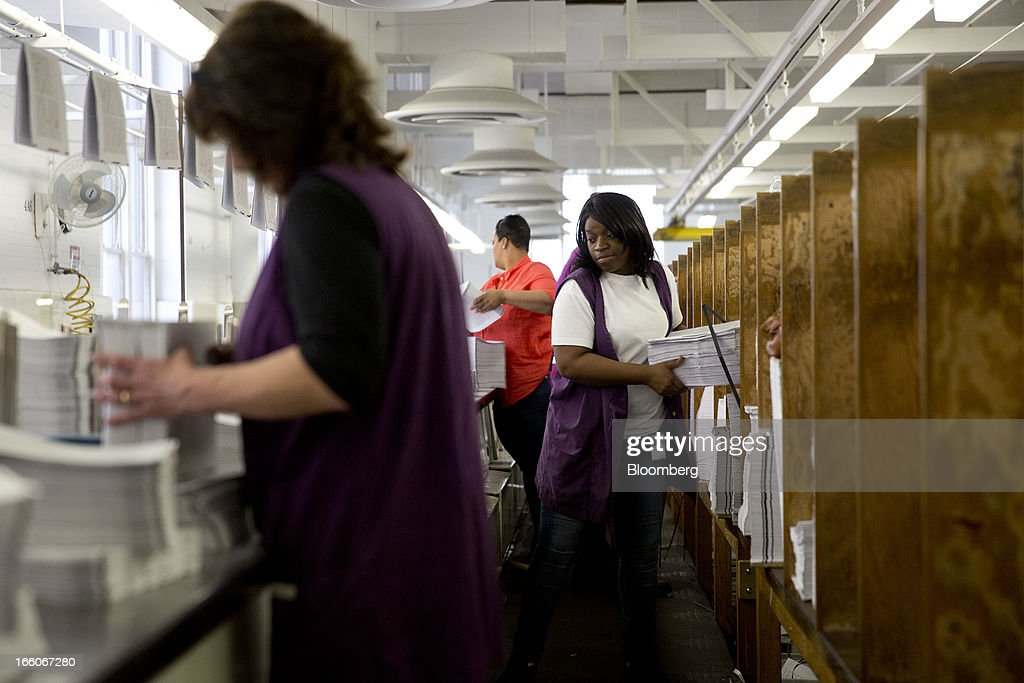 Employees organize copies of the Fiscal Year 2014 Budget at the U.S. Government Printing Office in Washington, D.C., U.S., on Monday, April 8, 2013. Less than a week after job-creation figures fell short of expectations and underscored the U.S. economy's fragility, President Barack Obama will send Congress a budget that doesn't include the stimulus his allies say is needed and instead embraces cuts in an appeal to Republicans. Photographer: Andrew Harrer/Bloomberg via Getty Images