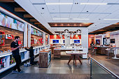 Employees organize merchandise inside an ATT Inc store in New York US on Friday July 22 2016 ATT posted secondquarter profit that was in line with...