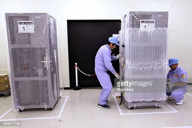 Employees pack a Fujitsu Ltd nextgeneration supercomputer for shipment at the Fujitsu IT Products Ltd plant in Hokuto City Ishikawa Prefecture Japan...