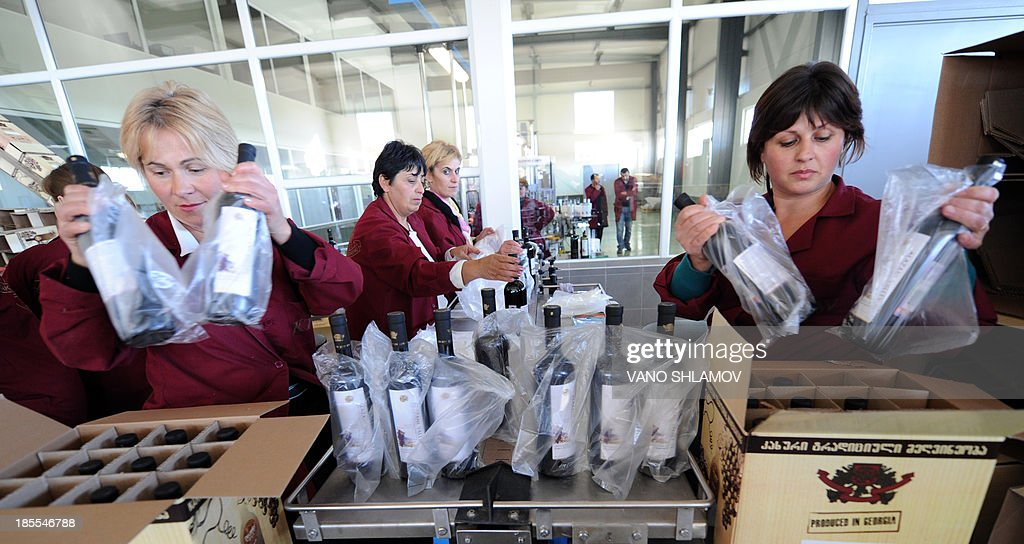 Employees pack bottles of wine at a winery in the Georgia's village of Patardzeuli, some 30 km east of the capital Tbilisi, on October 21, 2013.